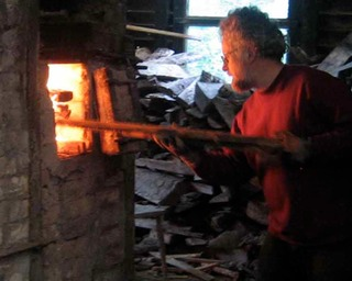 Robb Bradstock firing an Irish wood fired kiln in Co. Cork Ireland