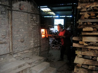 Robb firng an Irish wood-fired kiln in Co.Cork Ireland